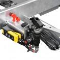 Fernbedienung, Batteriehauptschalter und Nothandpumpe
